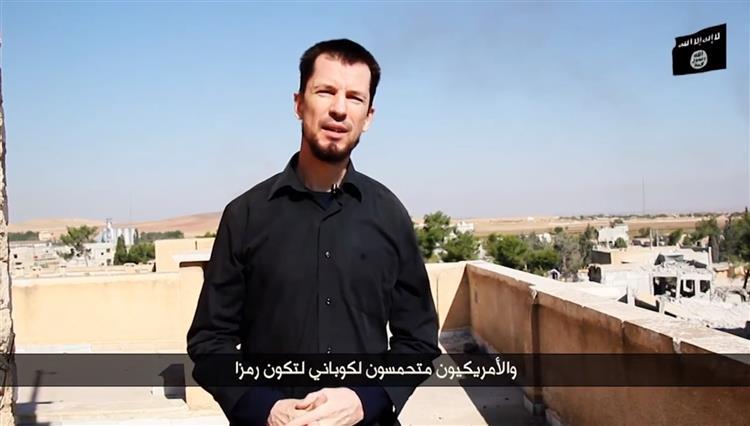 Estado Islâmico obriga jornalista refém a fazer 'tour' de Kobane